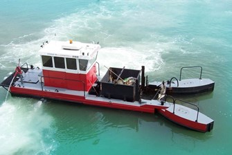 A Tugboat With Pinball Flippers: Have You Seen This Water Cleaning Machine Ambling Around the Bay?